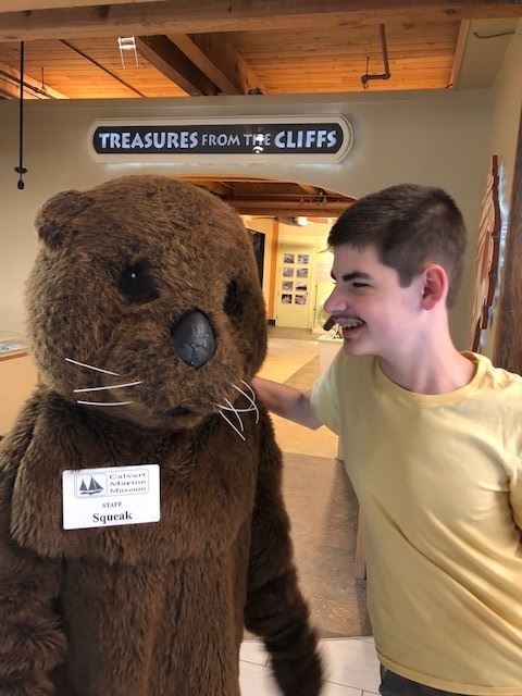 Museum visitor with Otter Mascot